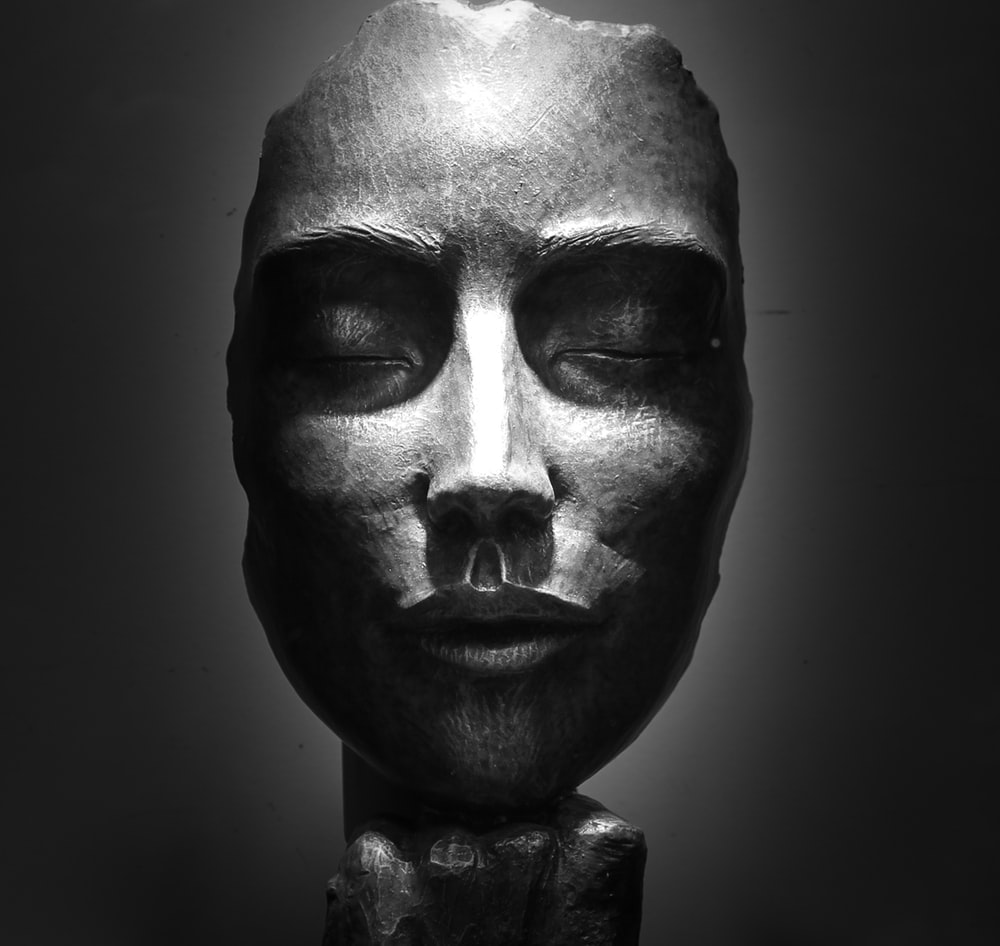 grey ceramic woman's face bust figurine