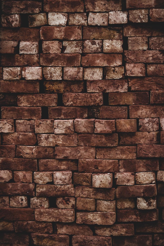 close photo of brown brick wall