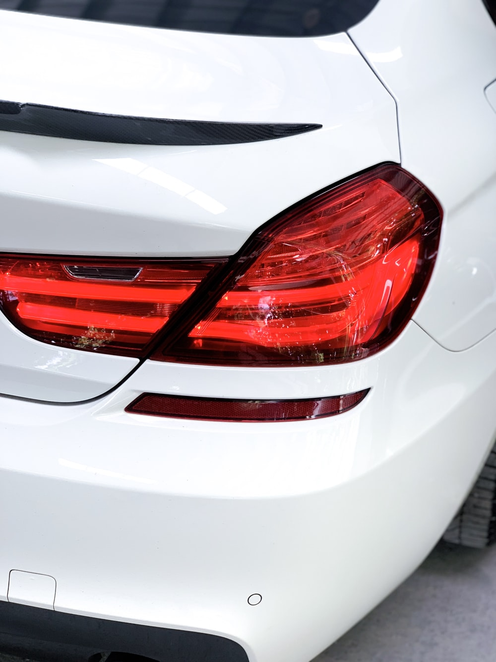 back view of white car