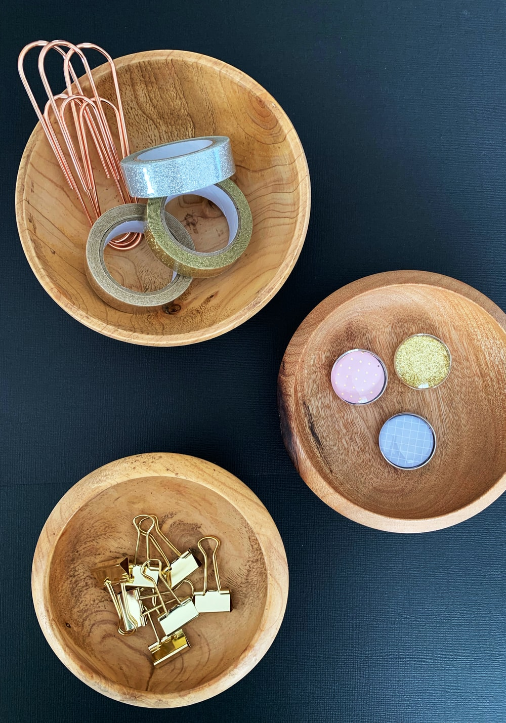 three round wooden bowls