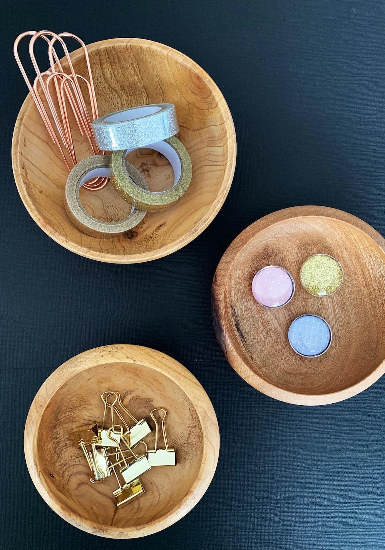 three round wooden bowls
