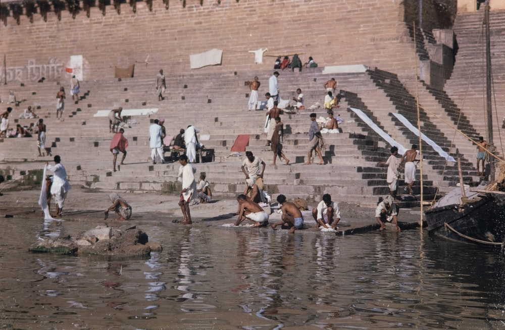 body of water with people taking bath