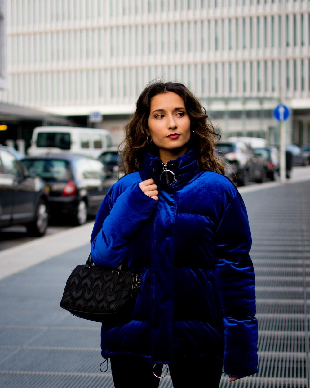 woman's blue velvet jacket
