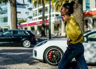 woman walking beside car