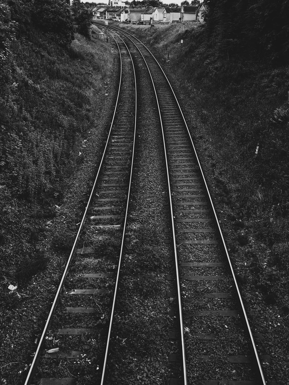 grayscale photography of train rail