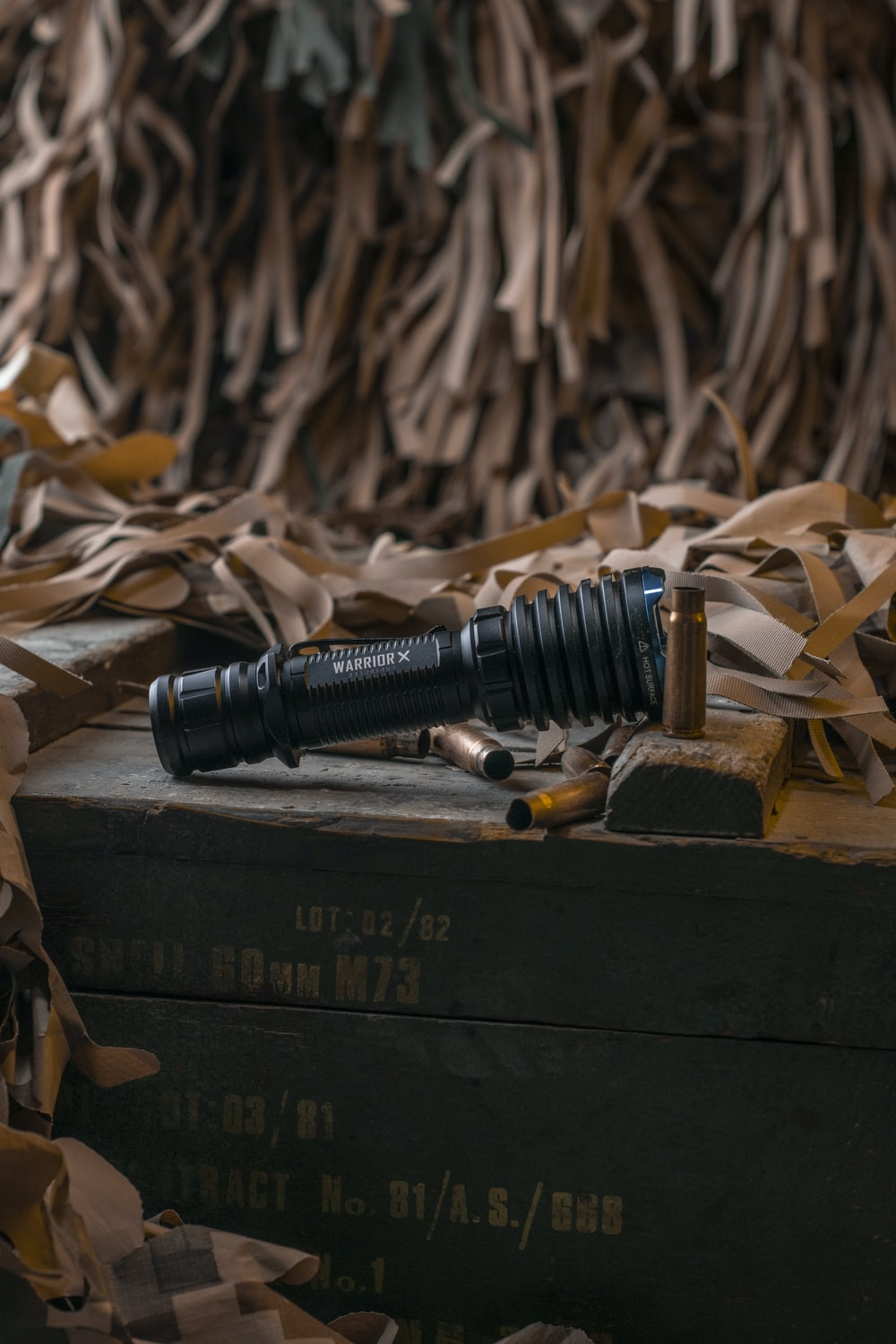 black scope on brown wooden box