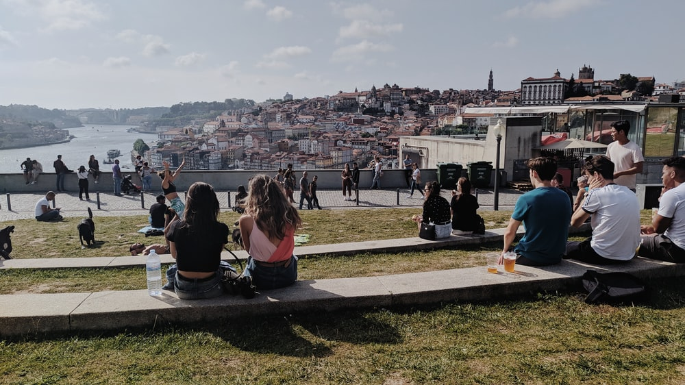 group of people sitting on ground