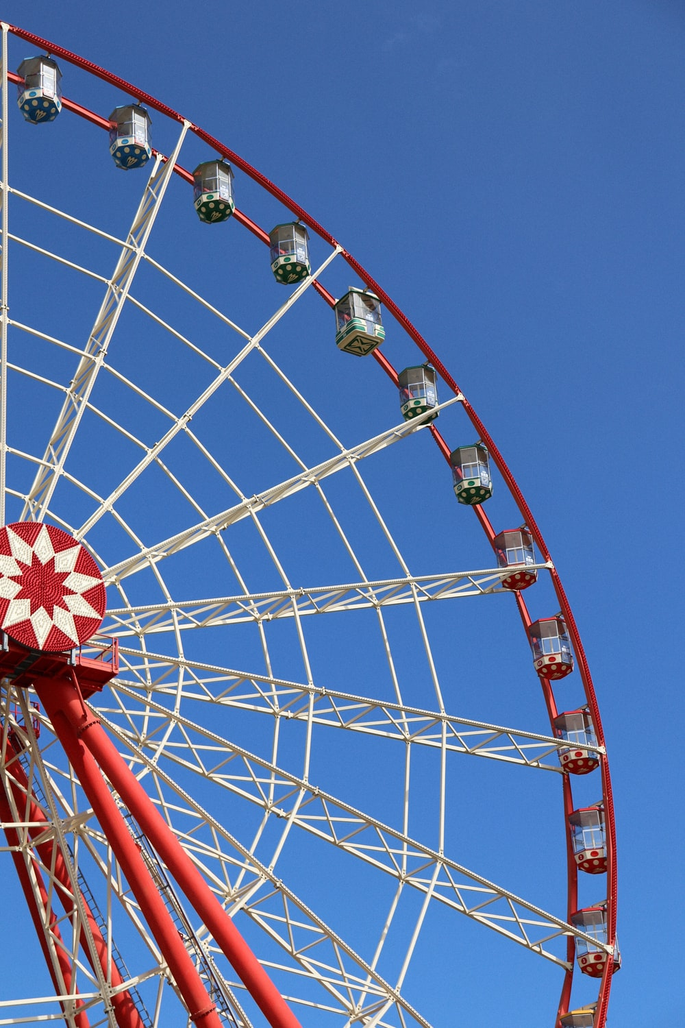 red and white Ferris Wheel under blue sky