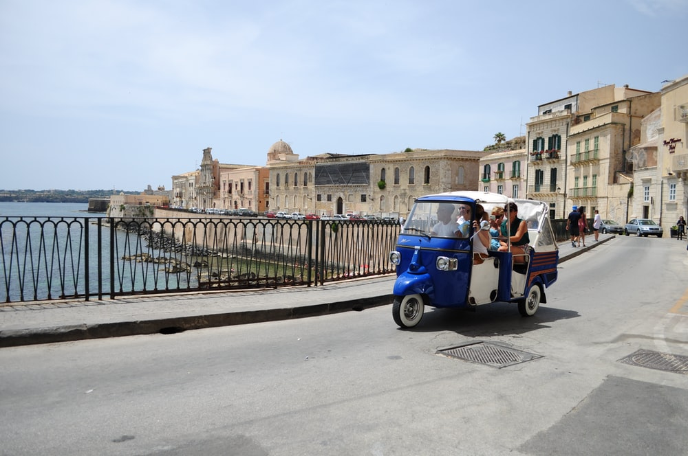 people riding auto rickshaw