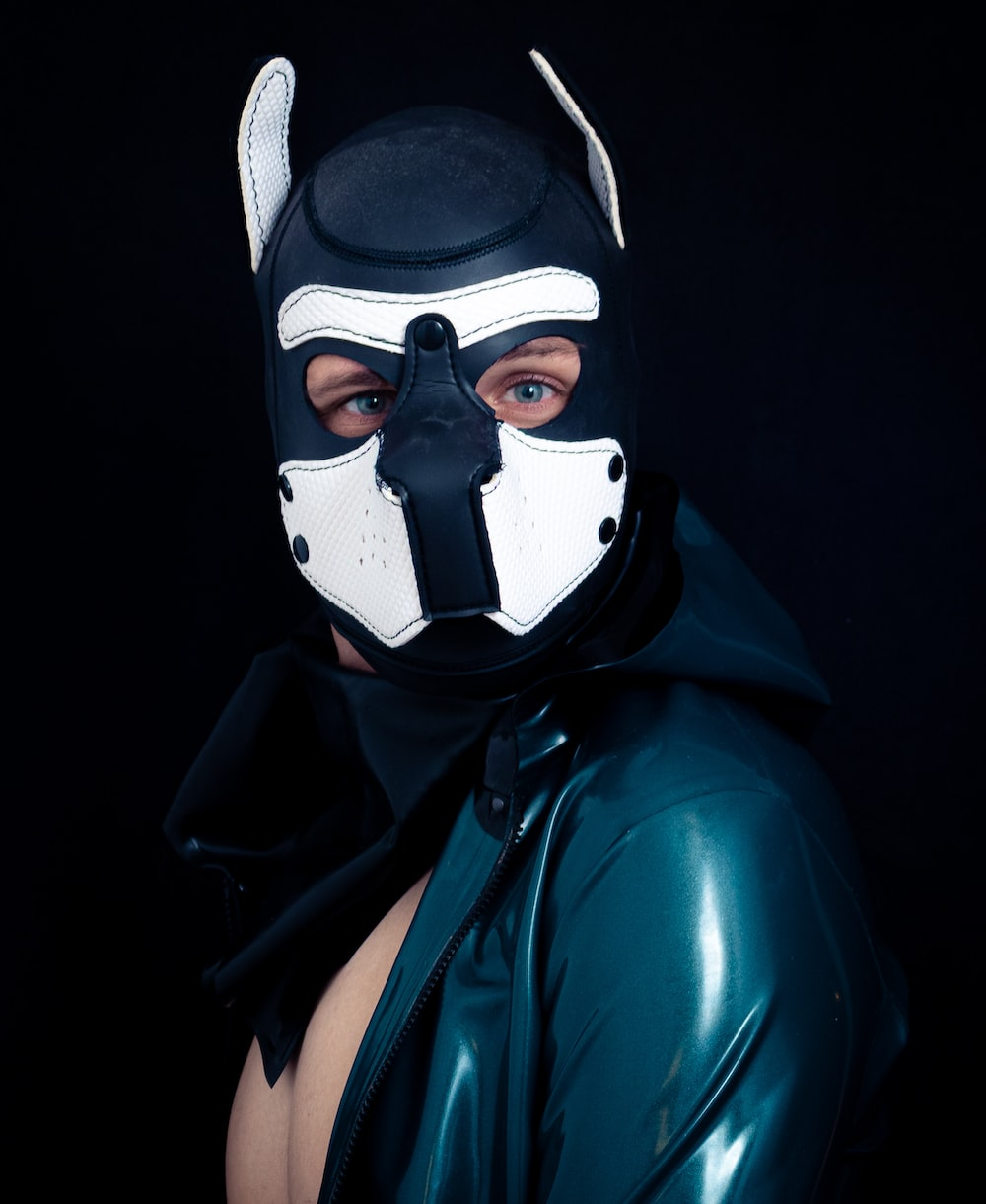 person wearing black and white full-face mask