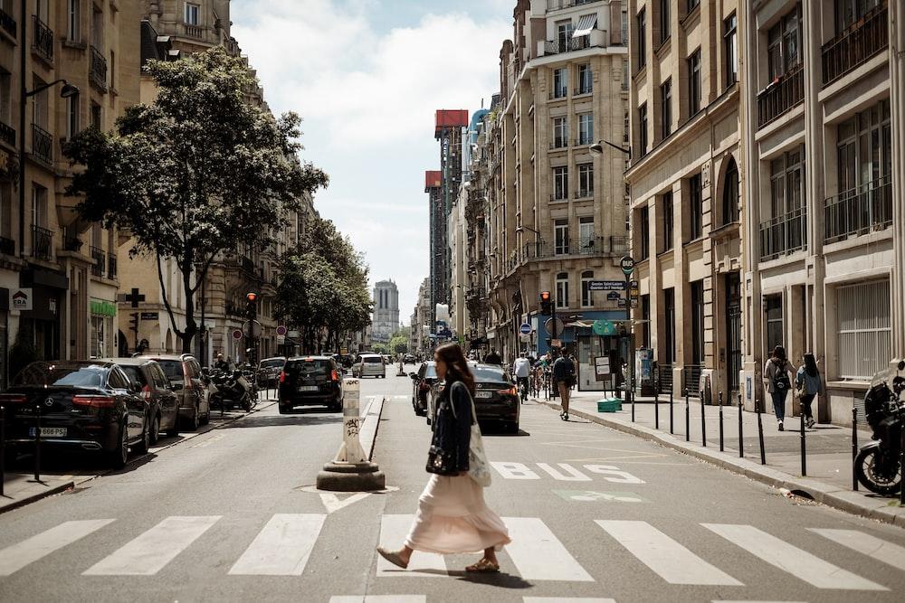 woman walking near street during daytime
