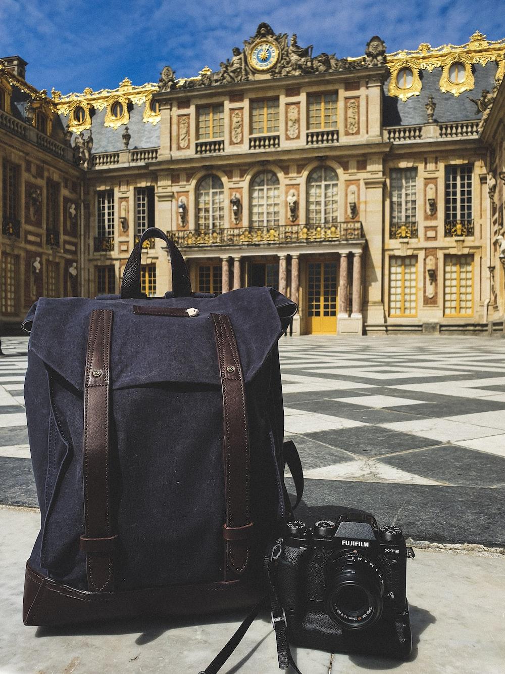 black DLSR camera and bag at Versailles