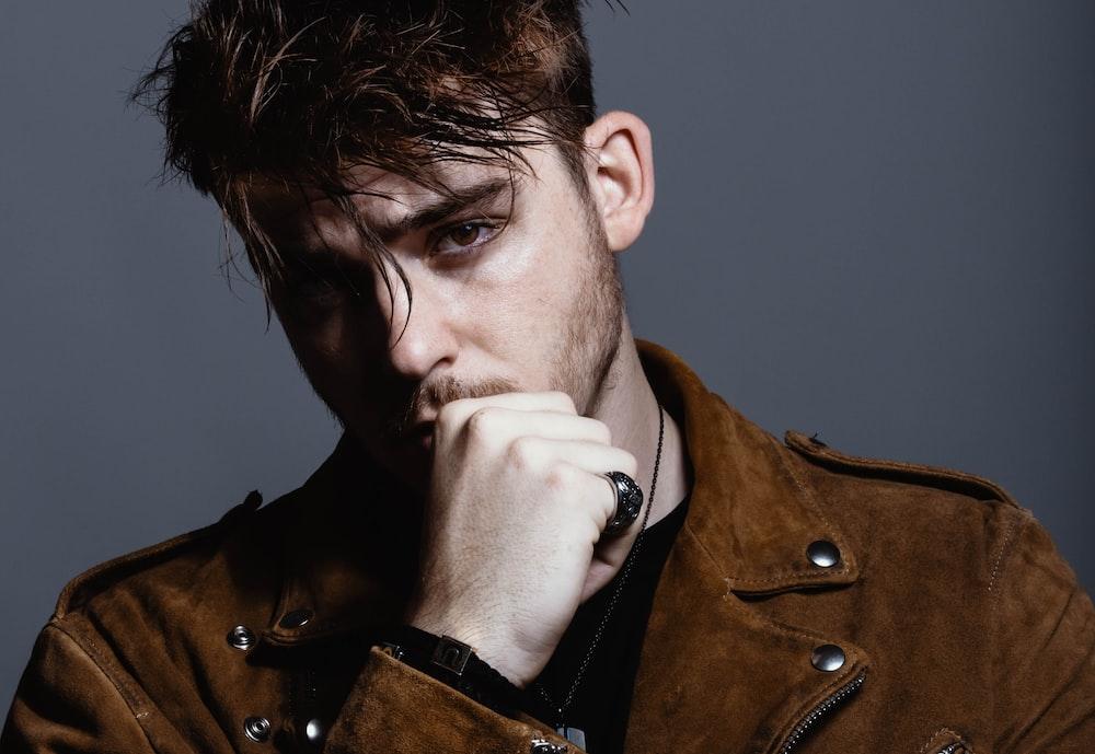 man wearing brown jacket