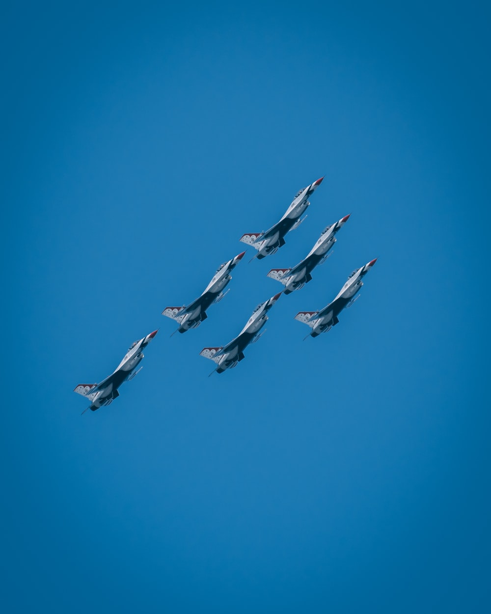 six gray-and-black jet planes