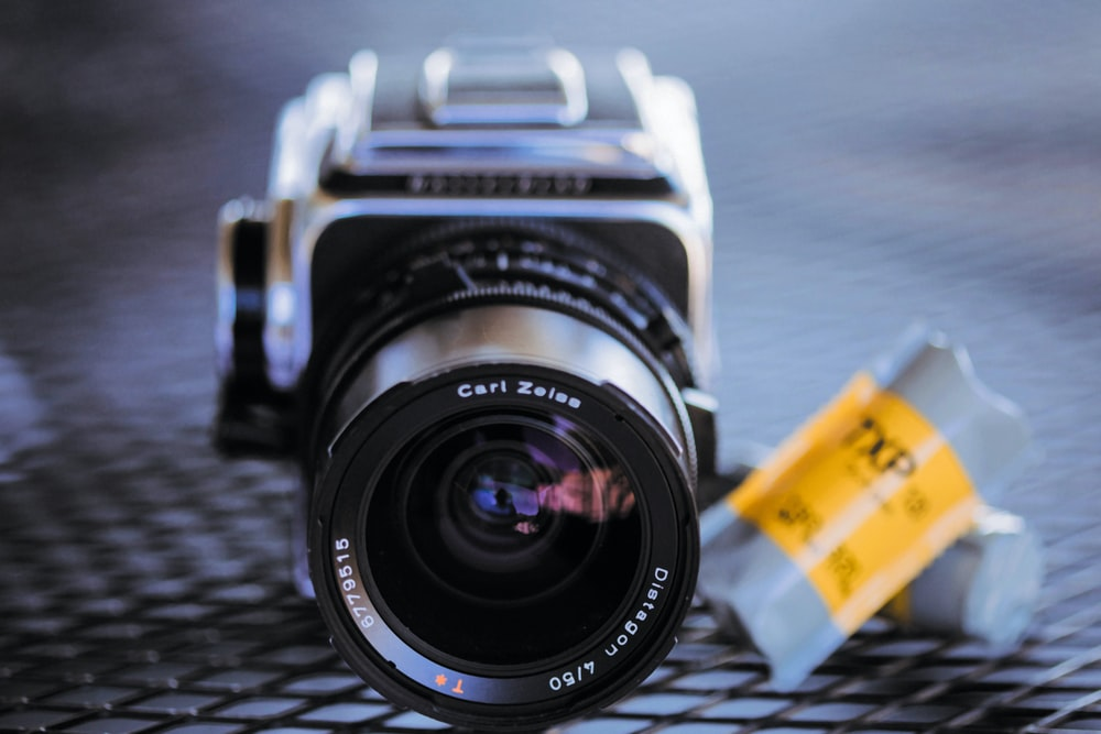 gray DSLR camera in close-up photo