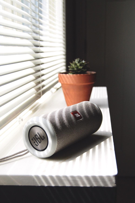 white JBL speaker