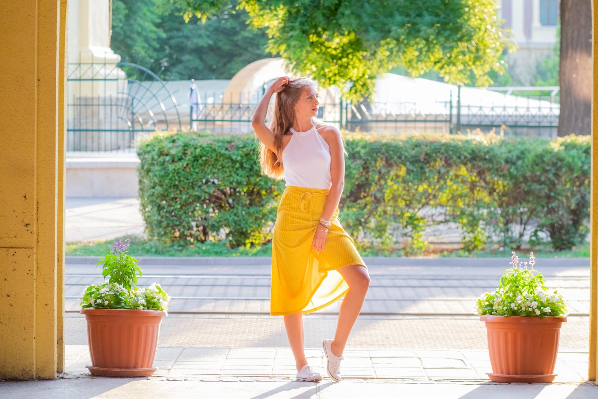 woman posing near plants