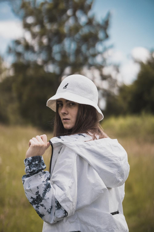 woman wearing white cap