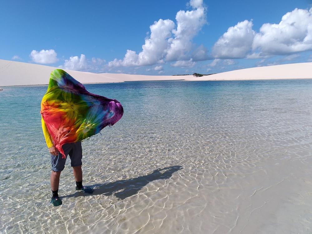 person standing in seashore