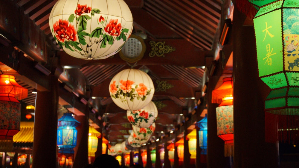 white floral lanterns on ceiling