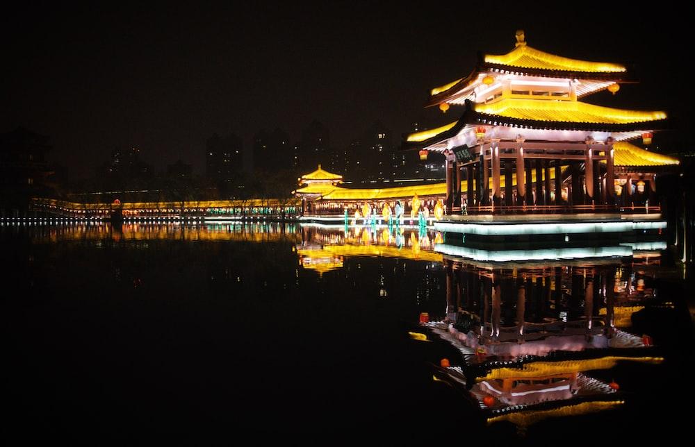 lighted pagoda near coastal area
