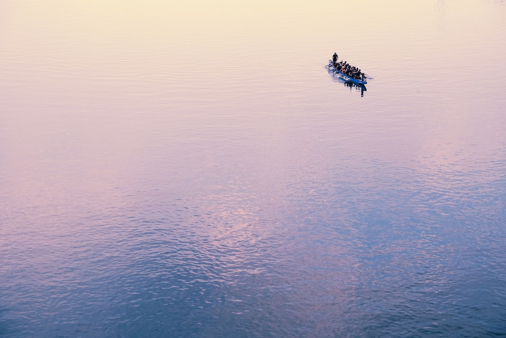 human-powered watercraft at the calm body of water