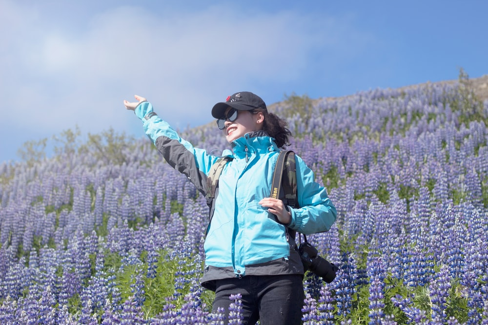 unknown person standing on lavender flower field