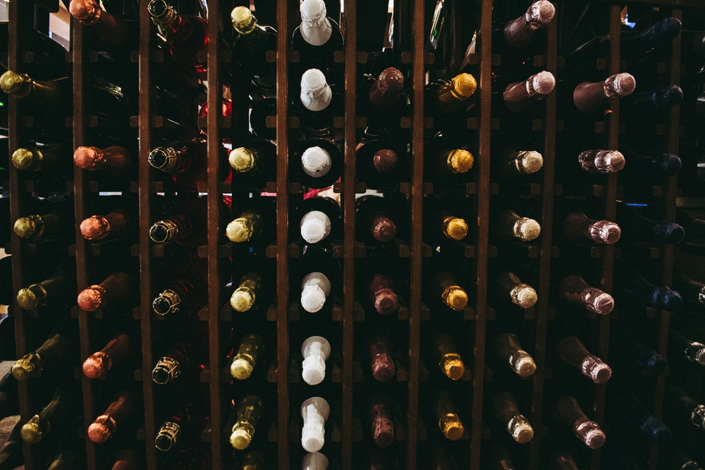 assorted wine bottle on racks