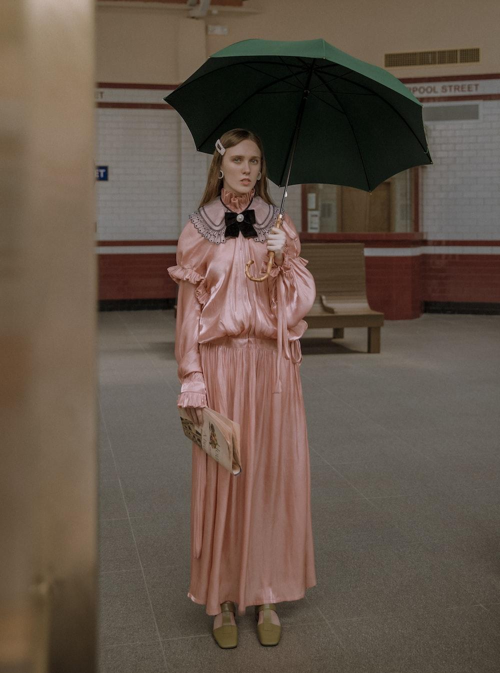 woman in pink dress under green umbrella