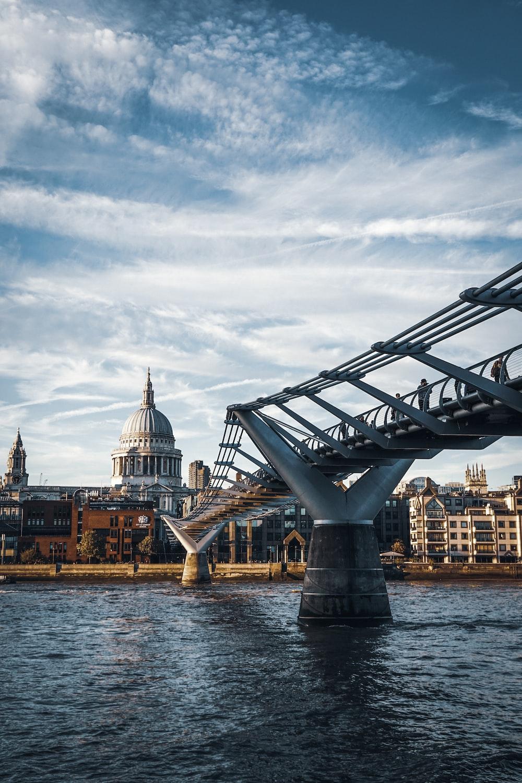 gray bridge on body of water photo