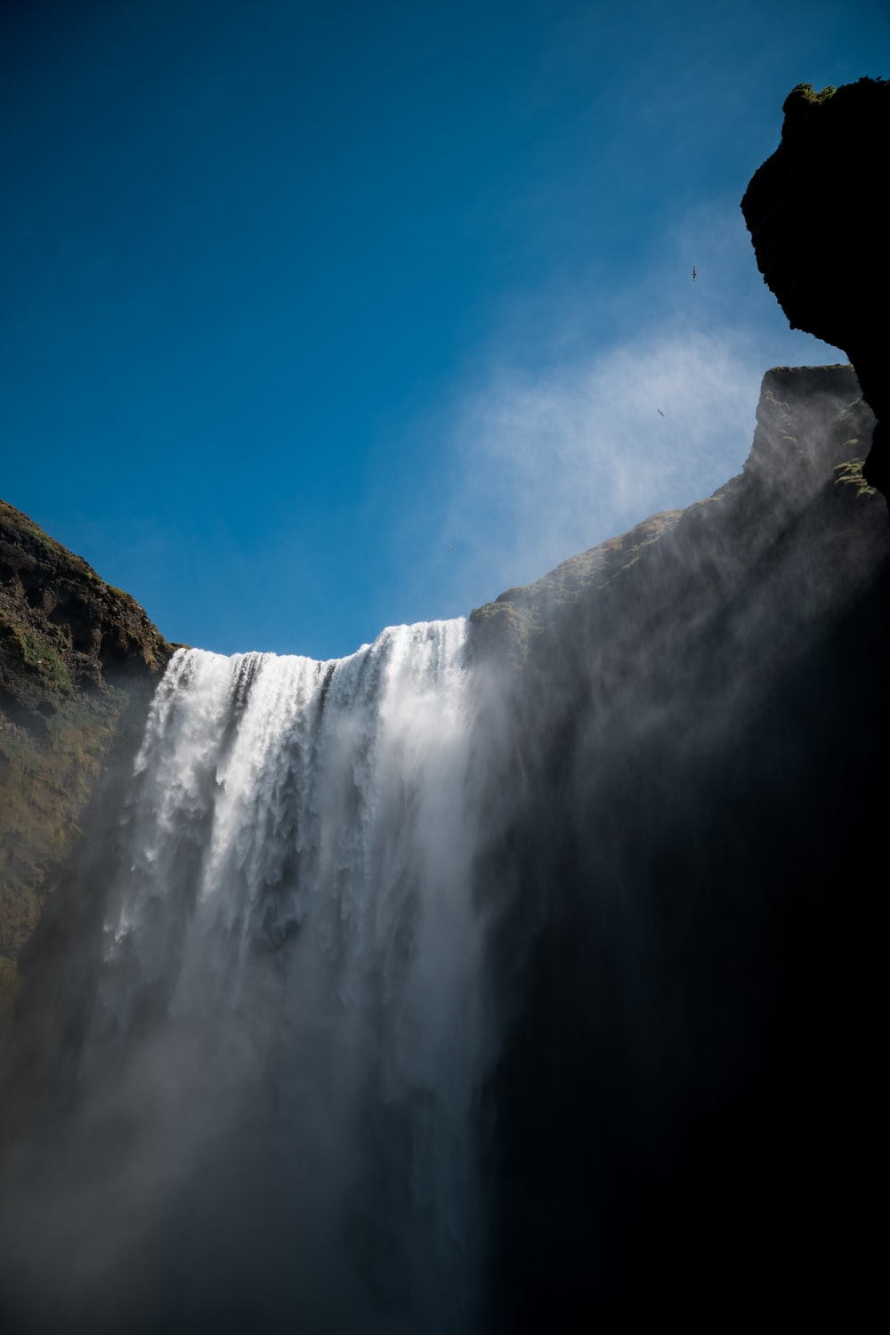 low angle view of waterfall at daytime