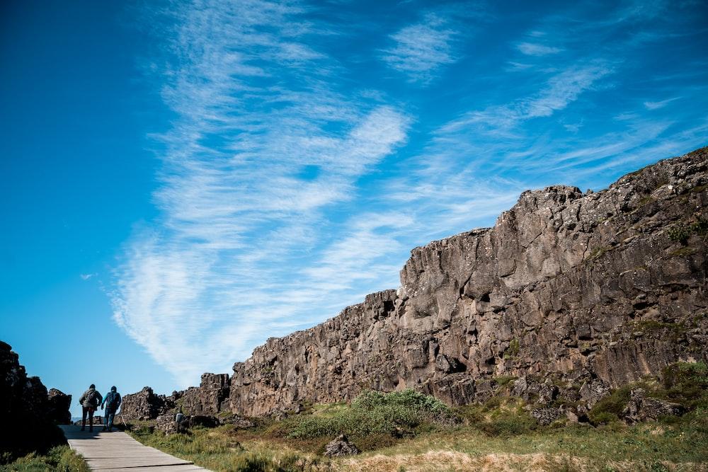 people walking near rock formations