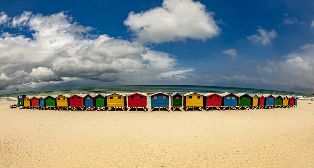 multicolored painted house beside beach