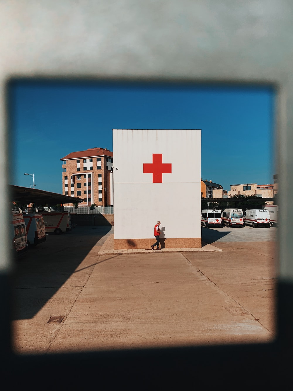 white and red cross logo