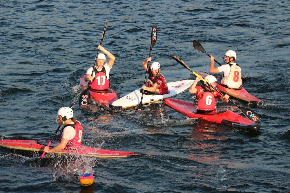 people on kayak on rippling body of water