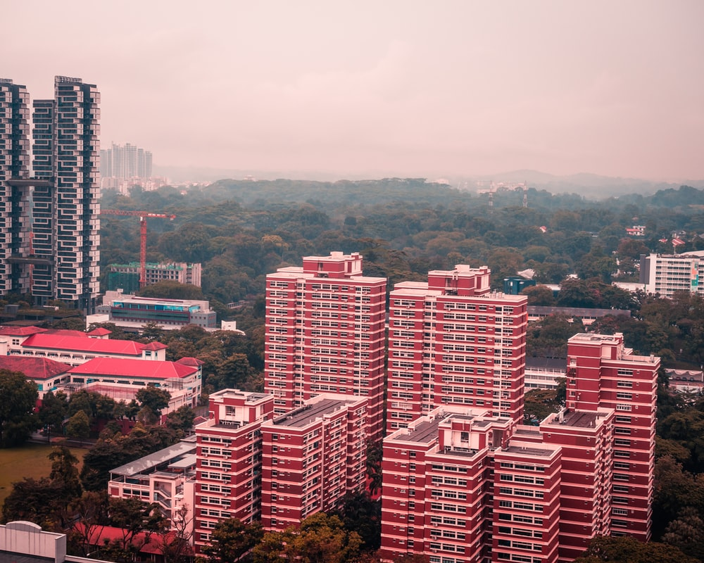 aerial view of red painted high rise buildings