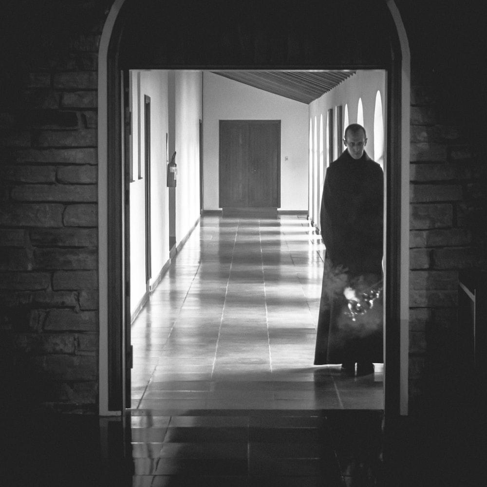man standing at the side of the open door