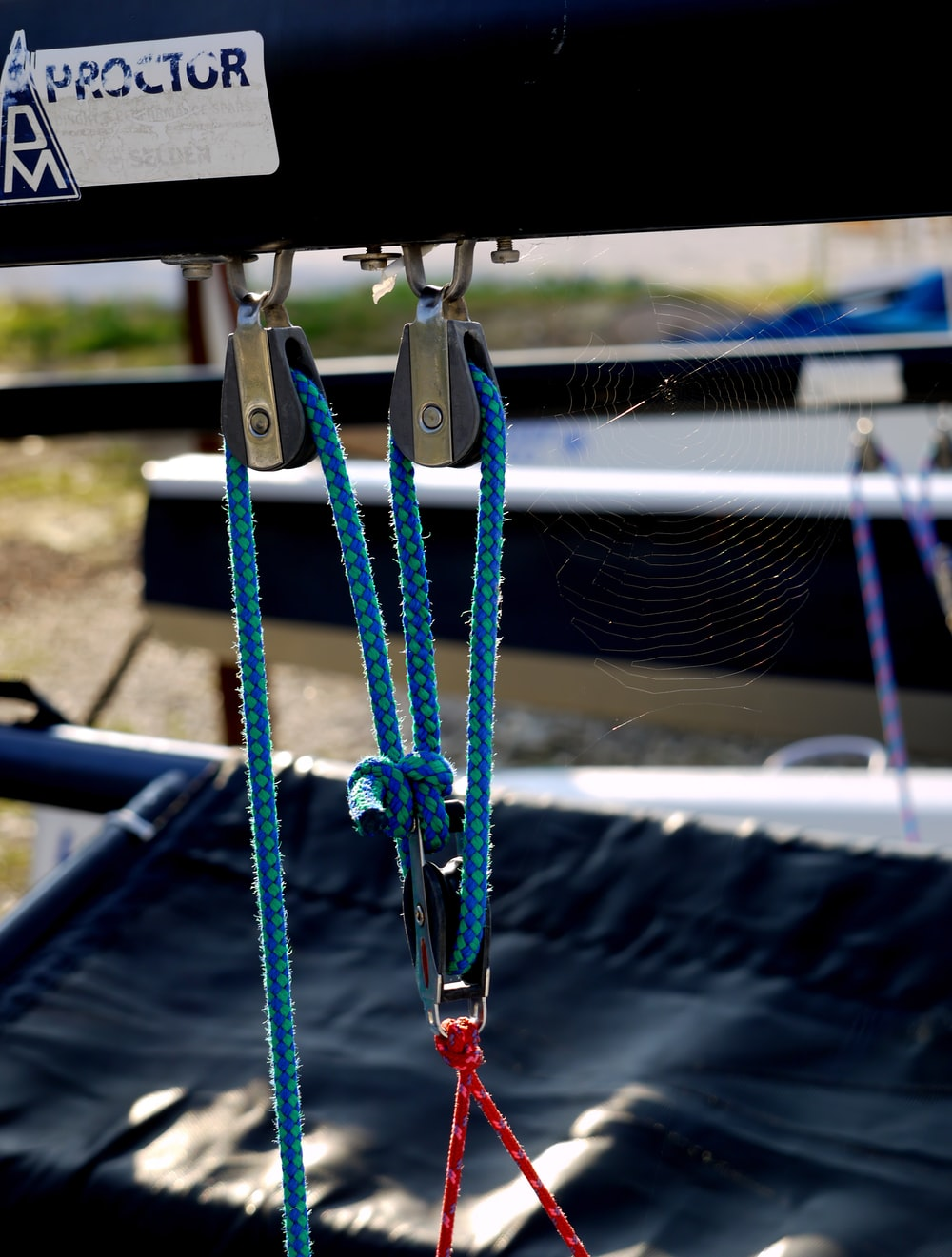 shallow focus photo of blue rope