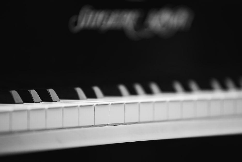 photo of white and black piano