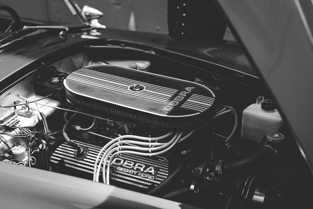 grayscale photo of engine bay