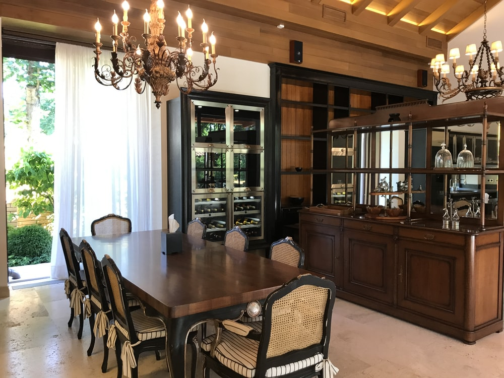 rectangular brown wooden dining table set