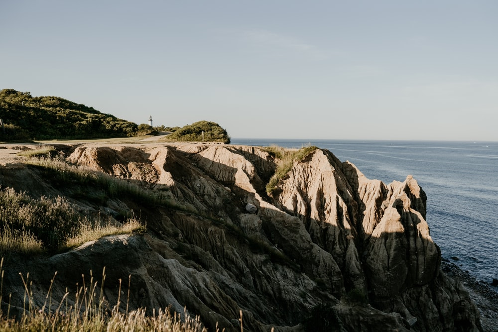landscape photo of mountains near ocean during daytime