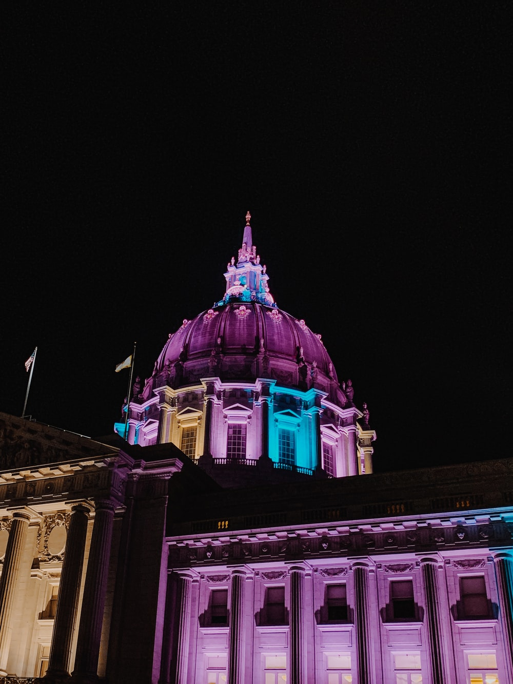 purple lighted dome building at nighttime