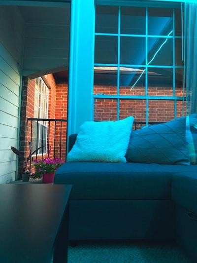 sofa with pillows near opened door