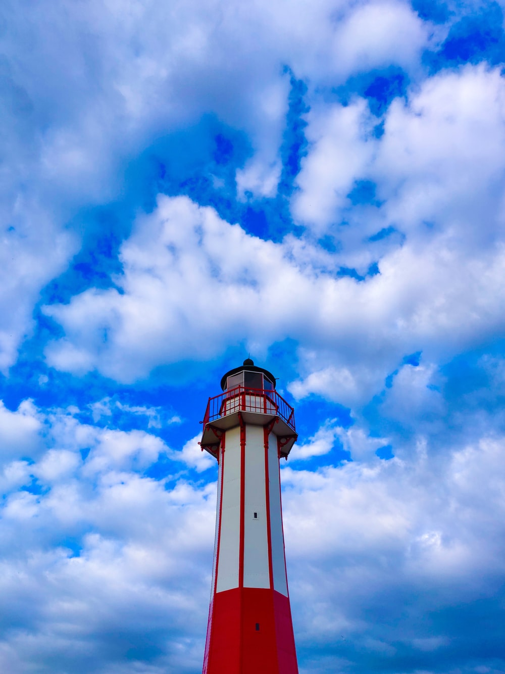 red and white lighthouse during day