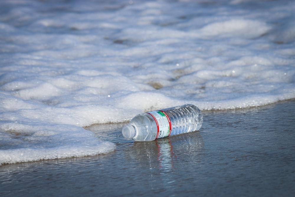 water plastic bottle on seashore