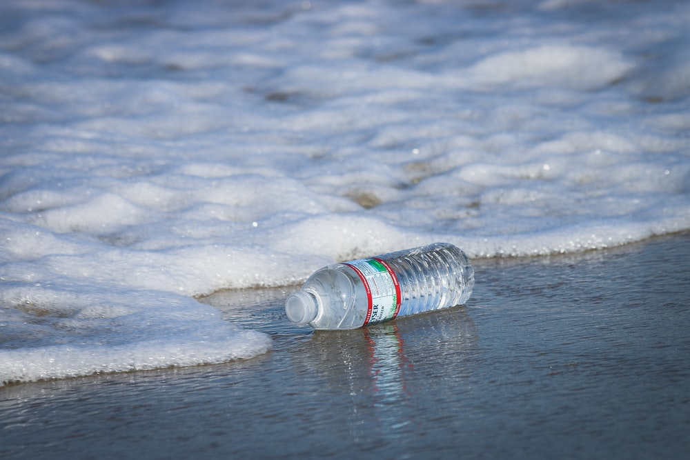 water plastic bottle on seashore