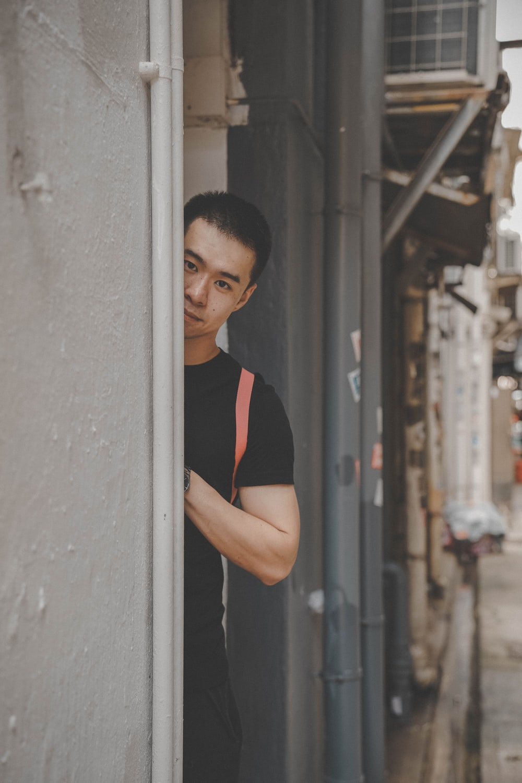 man standing near wall
