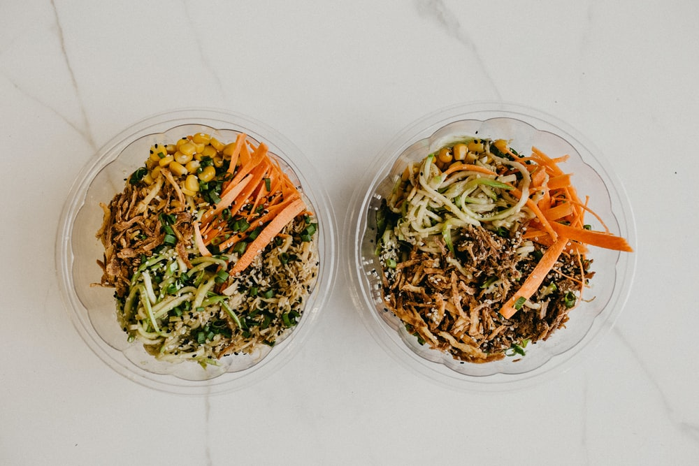 sliced vegetables on clear glass bowls