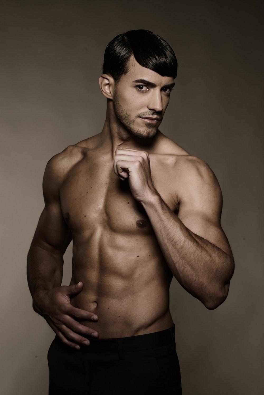 topless man wearing black shorts